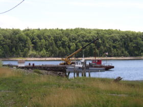 Wharf and barge in the Penobscot River in Winterport (2003)