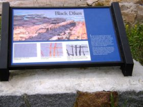 "sign: ""Black Dikes"" at Schoodic Point (2004)"
