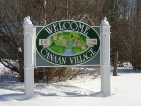 Sign: Welcome to Canaan Village (2005)