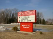 "Sign: ""Katahdin Middle & High School, Home of the Cougars"" in Stacyville"