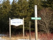 "Sign: ""Welcome to Patten,"" ""Town Line, Patten, South Patten"