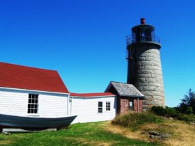 Monhegan Museum with dory on exhibit and attached Monhegan Light (2007)