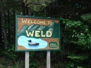 "sign: ""Welcome to Weld, 1816"" with Loon on Route 156 (2008)"