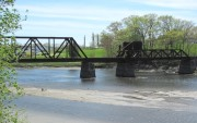 Railroad draw bridge in the St. George River, south of Route 1, dividing Thomaston from  Warren