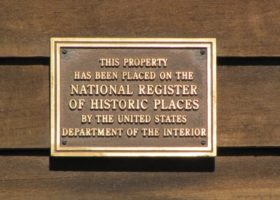 "Plaque: ""This property has been placed on the National Register of Historic Places . . . ."" in Limington Village"