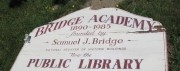 "sign: ""Bridge Academy, 1890-1985, founded by Samuel J. Bridge, National Register of Historic Buildings, Now the Public Library"" (2010)"