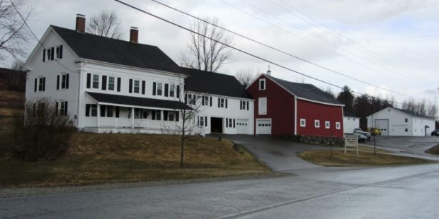 Large House and Red Barn with sign: Union River Telephone @