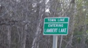 sign: Town Line, Entering Lambert Lake (2013)