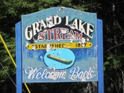 Sign: Grand Lake Stream, Welcome Back, on the Milford Road