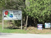 """Sign: Leen's Lodge"""" and for sale signs on the Milford Road"""