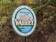 "Sign: . . . Welcomes You to the River Valley . . . ."" on Route 108 in West Peru"