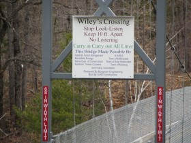 """Wiley's Crossing"" sign on the Suspension Bridge (2014)"