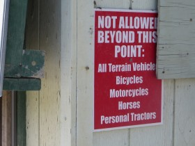 Notice at North Maine Woods Checkpoint on American Realty Road (2015)
