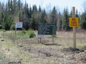 Signs at the intersection of American Realty Road and Pinkham Road