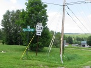 "sign: ""Moose Island RD"" and ""Perham RD"" and ""East 228"""