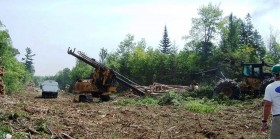 Skidder and Delimber on Plum Creek land in Bowerbank (2010)