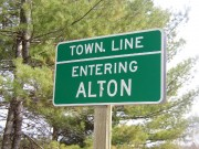 Sign: Town Line, Entering Alton