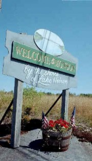 "Sign: ""Welcome to Monson, by the Shore of Lake Hebron"""